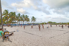People enjoy playing volleyball in Miami. MIAMI, USA - Aug 30, 2014: people enjoy playing volleyball in Miami, USA. South beach is famous for the public sports royalty free stock photos