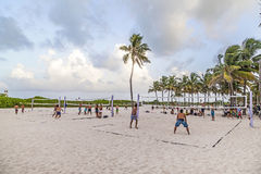 People enjoy playing volleyball in Miami. MIAMI, USA - Aug 30, 2014: people enjoy playing volleyball in Miami, USA. South beach is famous for the public sports stock photo