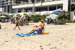 People enjoy and relax the beach Stock Images