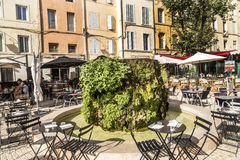 People enjoy the restaurant at the central market place with fou. AIX EN PROVENCE, FRANCE - AUG 19, 2016: people enjoy the restaurant at the central market place stock photo