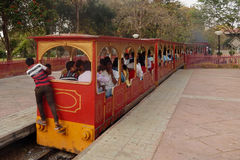 People enjoy ride on a mini steam powered train. In a public park on February 22,2016 in Hyderabad,India Royalty Free Stock Photography
