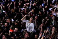 People enjoy rock-concert at a stadium Stock Photo