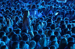 People enjoy rock-concert at a stadium Royalty Free Stock Photos