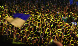 People enjoy rock-concert at a stadium Royalty Free Stock Photo