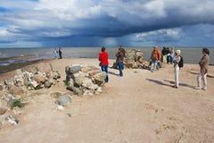 People enjoy the sea view at the Kolka cape in Kolka, Latvia. KOLKA, LATVIA - JULY 30, 2015: Unidentified people enjoy the sea view at the Kolka cape in Kolka royalty free stock photo