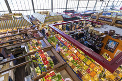 People enjoy shopping in the Kleinmarkthalle in Frankfurt, Germany. FRANKFURT, GERMANY - MAR 29, 2014: people enjoy shopping in the Kleinmarkthalle in Frankfurt stock photo