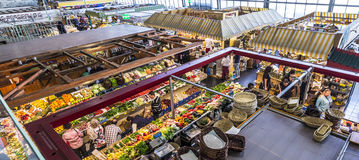 People enjoy shopping in the Kleinmarkthalle in Frankfurt, Germany. FRANKFURT, GERMANY - MAR 29, 2014: people enjoy shopping in the Kleinmarkthalle in Frankfurt royalty free stock photos