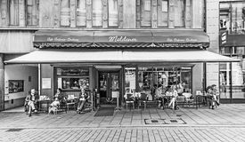 People enjoy sitting in famous cafe Maldaner in Wiesbaden. WIESBADEN, GERMANY - JUNE 21, 2015: people enjoy sitting in famous cafe Maldaner in Wiesbaden, Germany royalty free stock photography