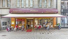 People enjoy sitting in famous cafe Maldaner in Wiesbaden. WIESBADEN, GERMANY - JUNE 21, 2015: people enjoy sitting in famous cafe Maldaner in Wiesbaden, Germany stock photo