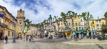 People enjoy sitting at the town hall square. AIX EN PROVENCE, FRANCE - JULY 8, 2015: people enjoy sitting at the central place in Aix en provence at town hall stock images