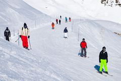 People enjoy ski and snowboard for winter holiday in Alps, Les Arcs 2000, Savoie, France, Europe stock photo