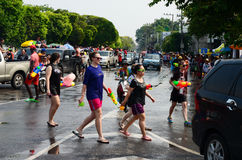 People enjoy splashing water together in songkran festival Stock Photos