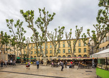 People enjoy the spring at the place de Richelme in Aix-en-Prove. AIX EN PROVENCE, FRANCE - JUNE 2, 2016: people enjoy the spring at the place Richelme in Aix-en Stock Photography