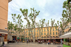 People enjoy the spring at the place de Richelme in Aix-en-Prove. AIX EN PROVENCE, FRANCE - JUNE 2, 2016: people enjoy the spring at the place Richelme in Aix-en Royalty Free Stock Photo