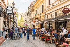 People Enjoy Spring Time Downtown Lipscani Street. BUCHAREST, ROMANIA - MAY 17, 2015: People Enjoy Spring Time Downtown Lipscani Street, One Of The Most Busiest stock photos