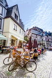 People enjoy the summer day at market place Royalty Free Stock Photo