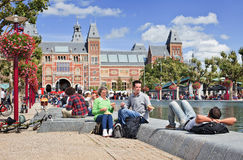 People enjoy a summer day on Museum Square, Amsterdam, Netherlands. AMSTERDAM-AUG. 24, 2014. People enjoy a summer day on Museum Square. Several museums are royalty free stock photo