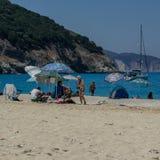 People enjoy the sun on the beach, Myrtos beach Kefalonia Greece royalty free stock photos