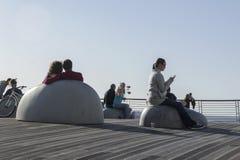 People enjoy the sun inTel-Aviv  harbor Royalty Free Stock Image