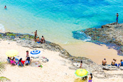 People enjoy a sunny day at Boa Viagem Beach in Bahia, Brazil Stock Images