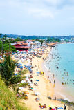 People enjoy a sunny day at Boa Viagem Beach in Bahia, Brazil. Royalty Free Stock Images