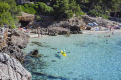 People enjoy a sunny day at Cala Gat in Mallorca, Spain. People enjoy a sunny day on a beach in Cala Gat in Mallorca, Spain Stock Photography