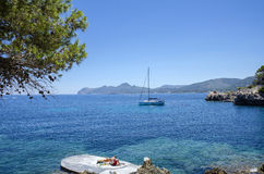 People enjoy a sunny day at Cala Gat in Mallorca, Spain. People enjoy a sunny day at Cala Gat near Cala Ratjada in Mallorca, Spain in July 2016 Stock Images