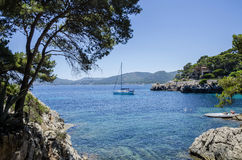 People enjoy a sunny day at Cala Gat in Mallorca, Spain. People enjoy a sunny day at Cala Gat near Cala Ratjada in Mallorca, Spain in July 2016 Stock Image