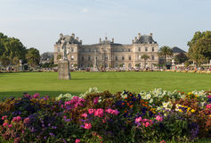 People enjoy sunny day in the Luxembourg Garden in Paris. Luxembourg Palace is the official residence of the French Senate royalty free stock images