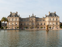 People enjoy sunny day in the Luxembourg Garden in Paris. Royalty Free Stock Images
