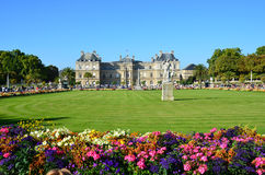 People enjoy sunny day in the Luxembourg Garden in Paris. Luxembourg Palace is the official residence of the French Senate stock photo