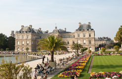 People enjoy sunny day in the Luxembourg Garden in Paris. Luxembourg Palace is the official residence of the French Senate stock images