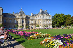 People enjoy sunny day in the Luxembourg Garden in Paris. stock image