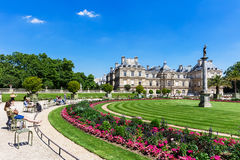 People enjoy sunny day in the Luxembourg Gardens in Paris, Franc Royalty Free Stock Photo
