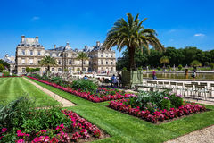 People enjoy sunny day in the Luxembourg Gardens in Paris, Franc. Paris, France - Jule 07, 2016: People enjoy sunny day in the Luxembourg Gardens in Paris Royalty Free Stock Photos