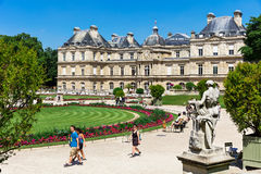 People enjoy sunny day in the Luxembourg Gardens in Paris, Franc Royalty Free Stock Image