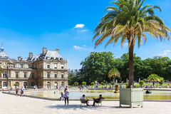 People enjoy sunny day in the Luxembourg Gardens in Paris, Franc Stock Image