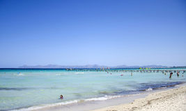 People enjoy a sunny day at Playa del Muro in Mallorca, Spain Royalty Free Stock Images