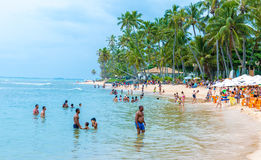 People enjoy a sunny day at Praia do Forte in Bahia, Brazil Royalty Free Stock Photo