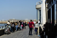 People enjoy a sunny day at Tel Aviv harbor Royalty Free Stock Photography