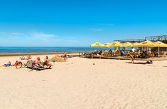 People enjoy the sunny spring day on the Baltic sea gulf beach in the Maiori resort, Jurmala. Stock Images