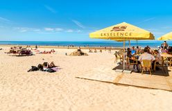 People enjoy the sunny spring day on the Baltic sea gulf beach in the Maiori resort, Jurmala. Stock Photography