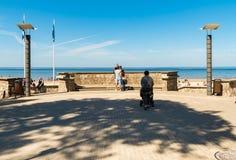 People enjoy the sunny spring day on the Baltic sea gulf beach in the Maiori resort, Jurmala. Stock Photo