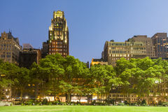People enjoy sunset light at Bryant Park Royalty Free Stock Images