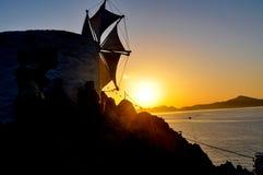 Windmill and sunset on patmos island stock photo