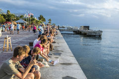 People enjoy the sunset point at Mallory square in Key Wes Stock Photo