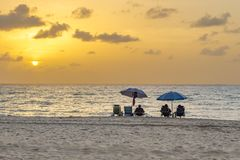 People enjoy the sunset at south beach. Miami royalty free stock image