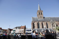 People enjoy the sunshine in the old city of amersfoort Stock Image