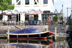 Vessels and a cosy terrace of Dara restaurant along the Eem river, Amersfoort, Netherlands  Royalty Free Stock Image