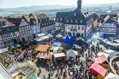 People enjoy the 24th Barbarossamarkt festival. GELNHAUSEN, GERMANY - MARCH 9. people enjoy the 24th Barbarossamarkt festival on March 9, 2014 in Gelnhausen royalty free stock photography